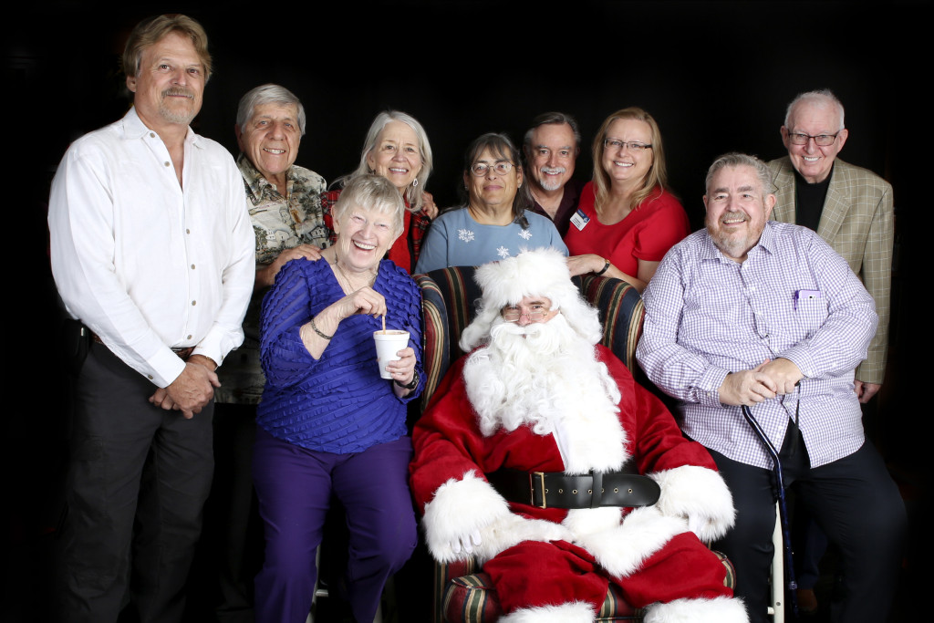 Members pose with Santa Claus
